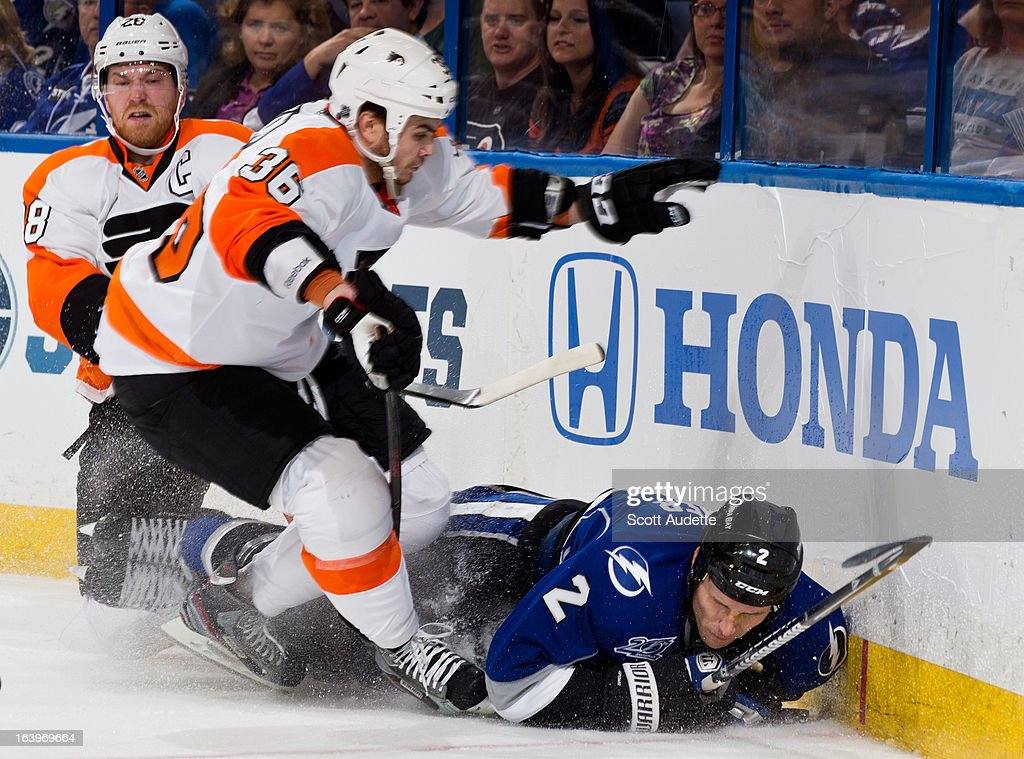 <a gi-track='captionPersonalityLinkClicked' href=/galleries/search?phrase=Eric+Brewer&family=editorial&specificpeople=202144 ng-click='$event.stopPropagation()'>Eric Brewer</a> #2 of the Tampa Bay Lightning hits the ice and while fighting for position with <a gi-track='captionPersonalityLinkClicked' href=/galleries/search?phrase=Zac+Rinaldo&family=editorial&specificpeople=4129574 ng-click='$event.stopPropagation()'>Zac Rinaldo</a> #36 of the Philadelphia Flyers during the second period of the game at the Tampa Bay Times Forum on March 18, 2013 in Tampa, Florida.