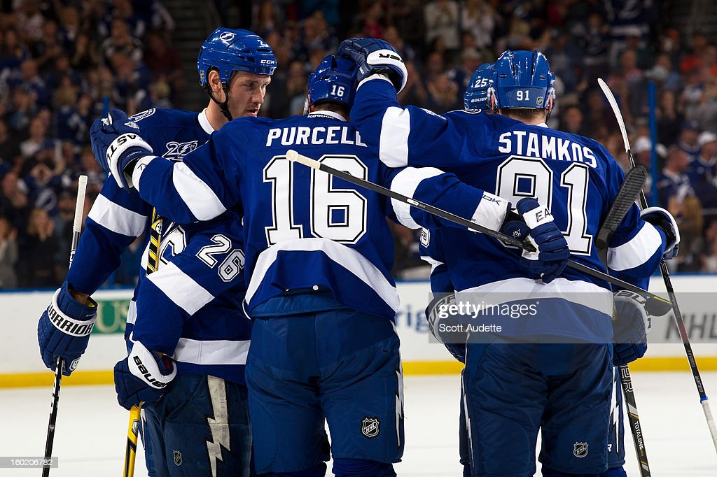 Eric Brewer #2 of the Tampa Bay Lightning, left, celebrates his goal with teammates Martin St. Louis #26, Teddy Purcell #16, and Steven Stamkos #91 during the first period of an NHL game against the Philadelphia Flyers at the Tampa Bay Times Forum on January 27, 2013 in Tampa, Florida.