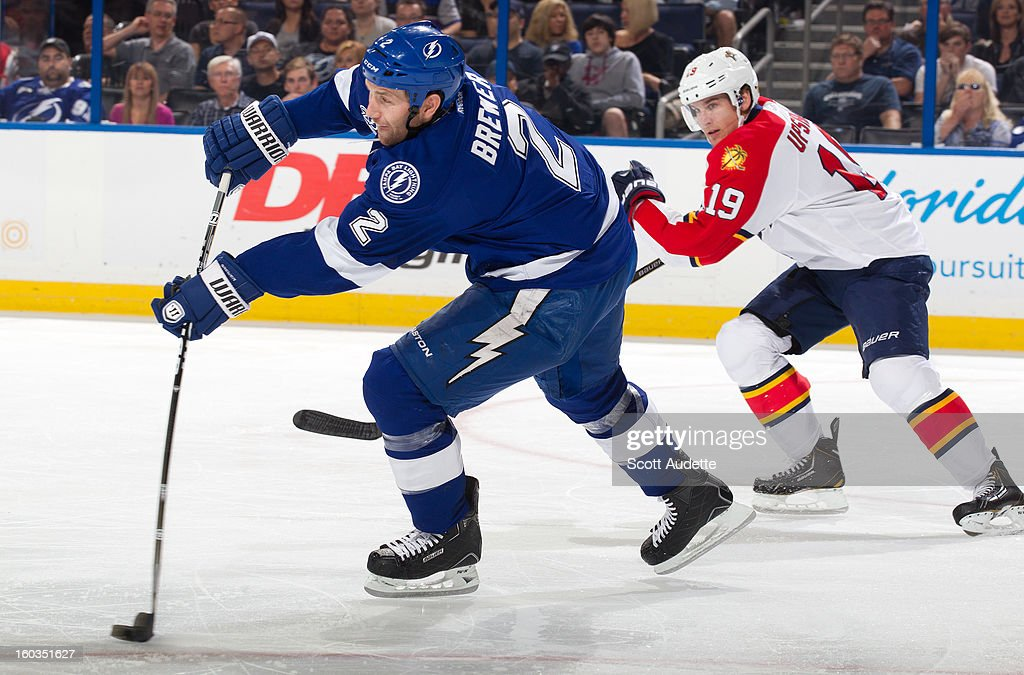 <a gi-track='captionPersonalityLinkClicked' href=/galleries/search?phrase=Eric+Brewer&family=editorial&specificpeople=202144 ng-click='$event.stopPropagation()'>Eric Brewer</a> #2 of the Tampa Bay Lightning makes a pass ahead of <a gi-track='captionPersonalityLinkClicked' href=/galleries/search?phrase=Scottie+Upshall&family=editorial&specificpeople=209198 ng-click='$event.stopPropagation()'>Scottie Upshall</a> #19 of the Florida Panthers at the Tampa Bay Times Forum on January 29, 2013 in Tampa, Florida.