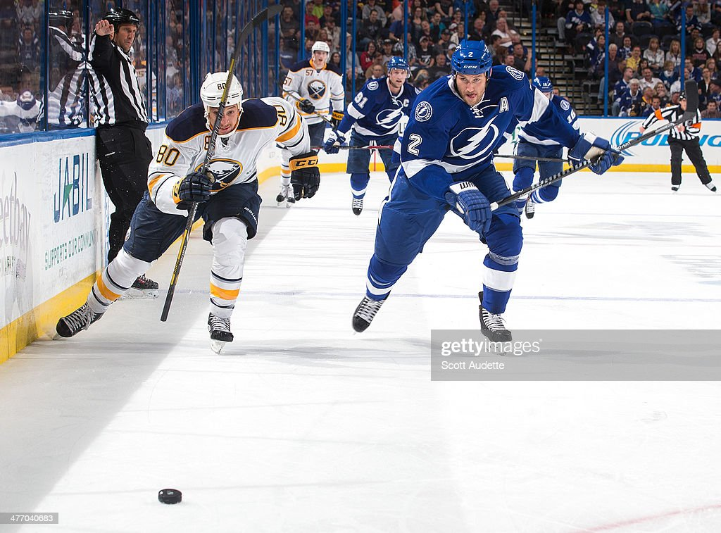 <a gi-track='captionPersonalityLinkClicked' href=/galleries/search?phrase=Eric+Brewer&family=editorial&specificpeople=202144 ng-click='$event.stopPropagation()'>Eric Brewer</a> #2 of the Tampa Bay Lightning races for the puck against Chris Stewart #80 of the Buffalo Sabres during the third period at the Tampa Bay Times Forum on March 6, 2014 in Tampa, Florida.