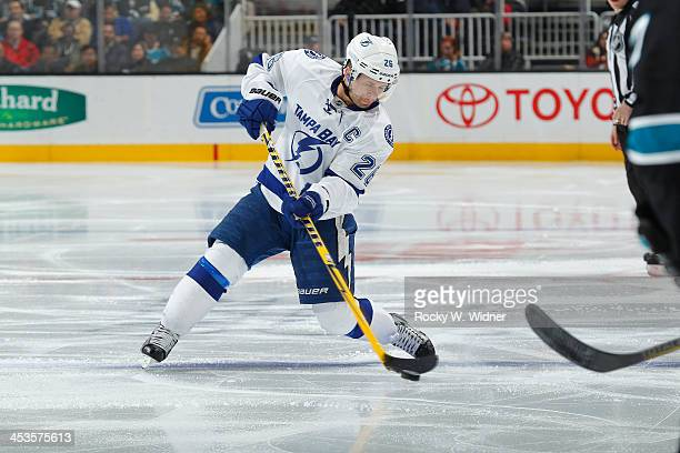 Eric Brewer of the Tampa Bay Lightning shoots the puck against the San Jose Sharks at SAP Center on November 21 2013 in San Jose California