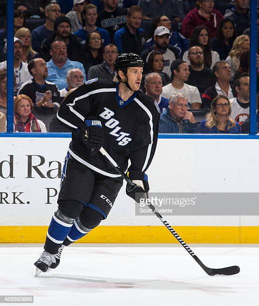 Eric Brewer of the Tampa Bay Lightning skates against the New York Islanders at the Amalie Arena on November 15 2014 in Tampa Florida