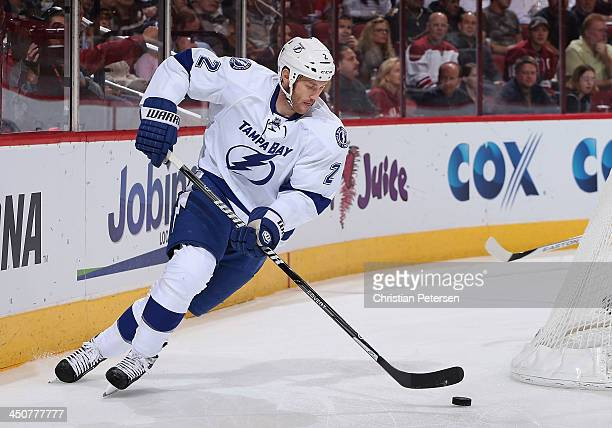 Eric Brewer of the Tampa Bay Lightning skates with the puck during the NHL game against the Phoenix Coyotes at Jobingcom Arena on November 16 2013 in...