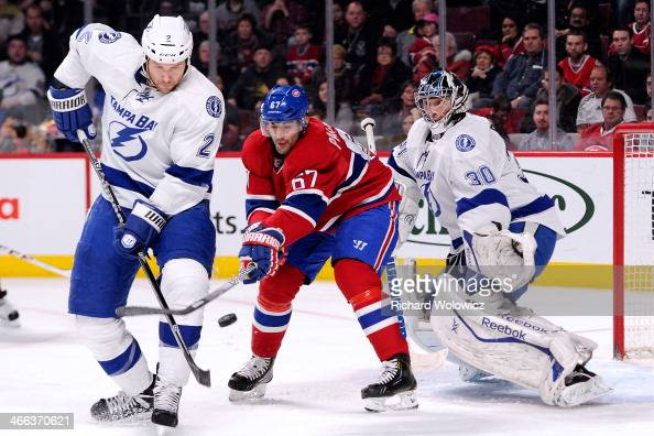 Eric Brewer of the Tampa Bay Lightning stops Max Pacioretty of the Montreal Canadiens from deflecting the puck in front of Ben Bishop of the Tampa...