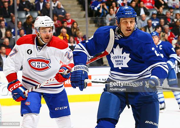 Eric Brewer of the Toronto Maple Leafs gets a high stick by Alex Galchenyuk of the Montreal Canadiens during NHL action at the Air Canada Centre...