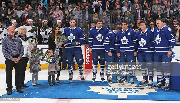 Eric Brewer of the Toronto Maple Leafs is honoured for playing 1000 NHL games prior to play between the Minnesota Wild and the Toronto Maple Leafs in...