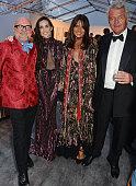 Eric Buterbaugh Demi Moore Countess Debonnaire von Bismarck and Count Leopold von Bismarck attend British Vogue's Centenary gala dinner at Kensington...