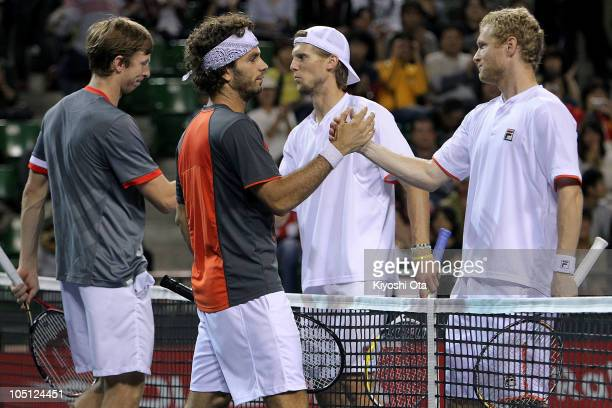 Eric Butorac of the United States and JeanJulien Roger of the Netherlands Antilles shake hands with Andreas Seppi of Italy and Dmitry Tursunov of...