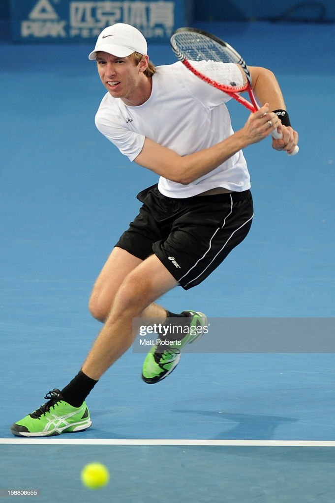 Eric Butorac plays a backhand in his doubles match with Paul Hanley against Lleyton Hewitt and Chris Guccione during day one of the Brisbane International at Pat Rafter Arena on December 30, 2012 in Brisbane, Australia.