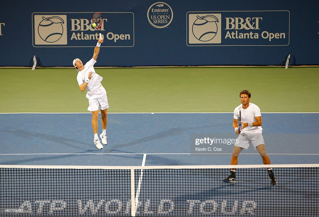 Eric Butorac returns an overhead slam to Gilles Muller of Luxembourg and Colin Fleming of Great Britain during the BB&T Atlanta Open at Atlantic Station on August 1, 2015 in Atlanta, Georgia.