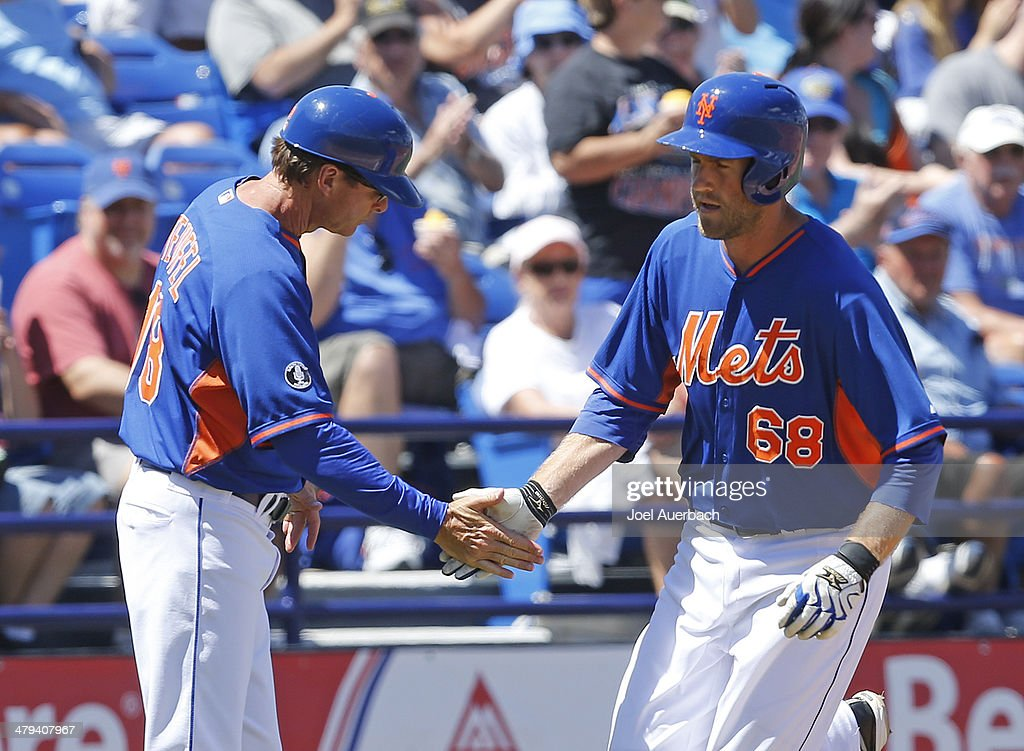 <a gi-track='captionPersonalityLinkClicked' href=/galleries/search?phrase=Eric+Campbell&family=editorial&specificpeople=90797 ng-click='$event.stopPropagation()'>Eric Campbell</a> #68 is congratulated by Third base coach Tim Teufel #18 of the New York Mets after hitting a home run against the Detroit Tigers during a spring training game at Tradition Field on March 18, 2014 in Port St. Lucie, Florida. The Mets defeated the Tigers 5-4.