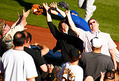 Eric Campbell of the New York Mets attempts to catch a fly ball in foul territory in the first row of seats during the game against the Pittsburgh...