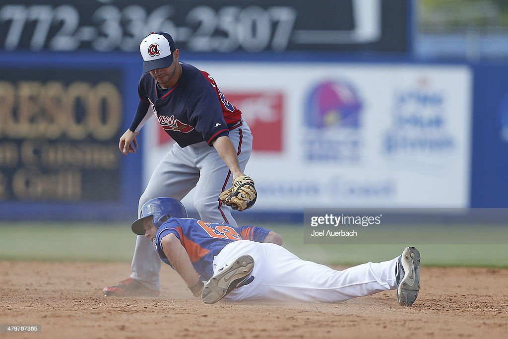 <a gi-track='captionPersonalityLinkClicked' href=/galleries/search?phrase=Eric+Campbell&family=editorial&specificpeople=90797 ng-click='$event.stopPropagation()'>Eric Campbell</a> #68 of the New York Mets hits a double and is safe ahead of the throw to Tommy La Stella #84 of the Atlanta Braves in the eighth inning during a spring training game at Tradition Field on March 20, 2014 in Port St. Lucie, Florida. The Mets defeated the Braves 7-6.