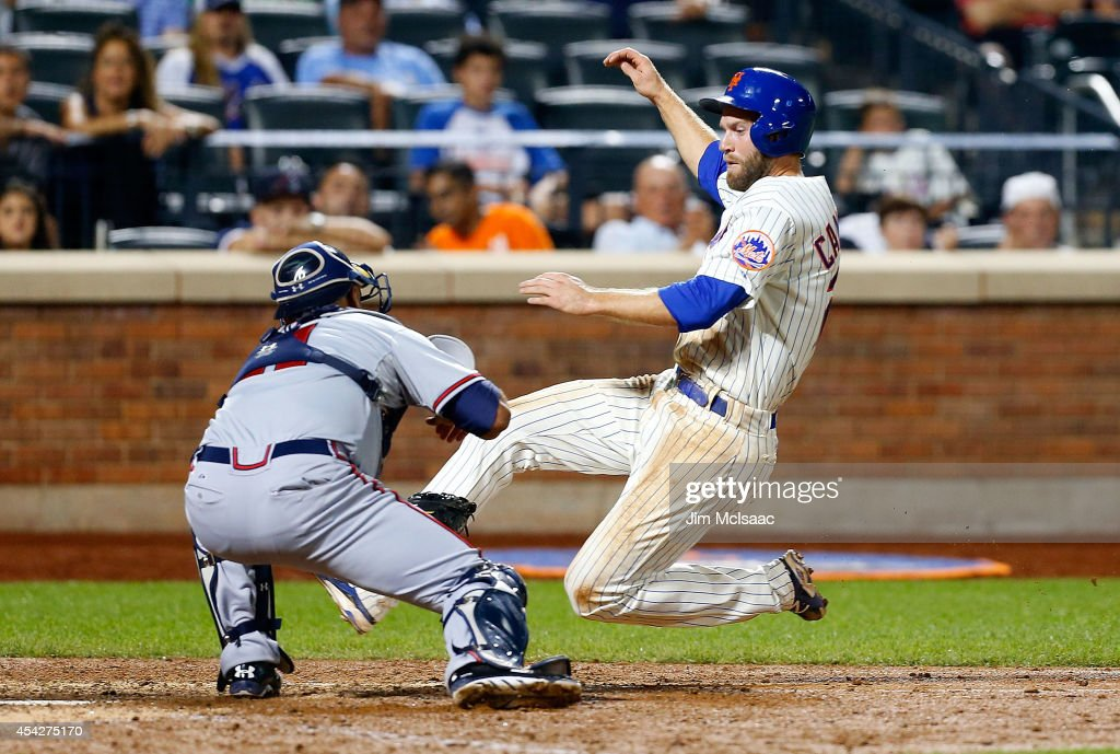 Eric Campbell #29 of the New York Mets is tagged out at home by Gerald Laird #11 of the Atlanta Braves in the ninth inning at Citi Field on August 27, 2014 in the Flushing neighborhood of the Queens borough of New York City.
