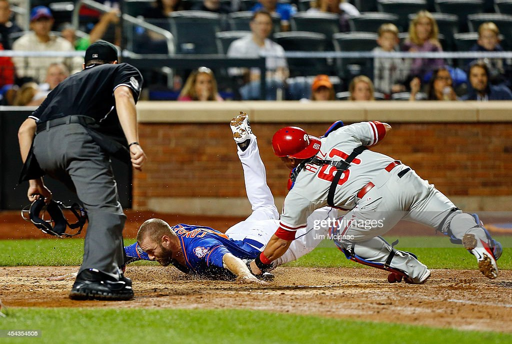 Eric Campbell of the New York Mets steals home in the seventh inning ahead of the tag from Carlos Ruiz of the Philadelphia Phillies at Citi Field on...