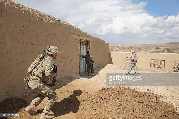 Eric Cannon from Dothan Alabama with the US Army's 2nd Battalion 87th Infantry Regiment 3rd Brigade Combat Team 10th Mountain Division keeps watch...