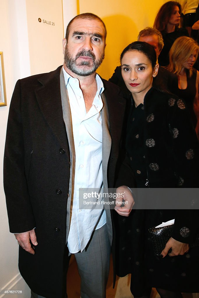 Eric Cantona and his wife <a gi-track='captionPersonalityLinkClicked' href=/galleries/search?phrase=Rachida+Brakni&family=editorial&specificpeople=609273 ng-click='$event.stopPropagation()'>Rachida Brakni</a> attend the 'Diner des Amis du Musee d'Art Moderne' at Musee d'Art Moderne on October 21, 2014 in Paris, France.