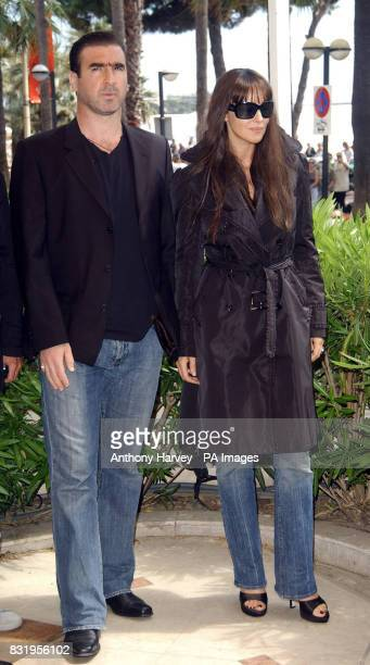 AP OUT Eric Cantona and Monica Bellucci pose for photographers during the photocall for 'Le Deuxieme Souffle' at the Carlton Hotel during the 59th...