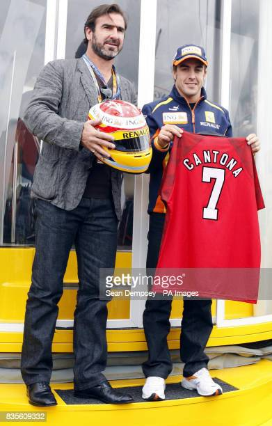 Eric Cantona and Renault's Fernando Alonso during a photocall prior to the during the British Grand Prix at Silverstone Northamptonshire