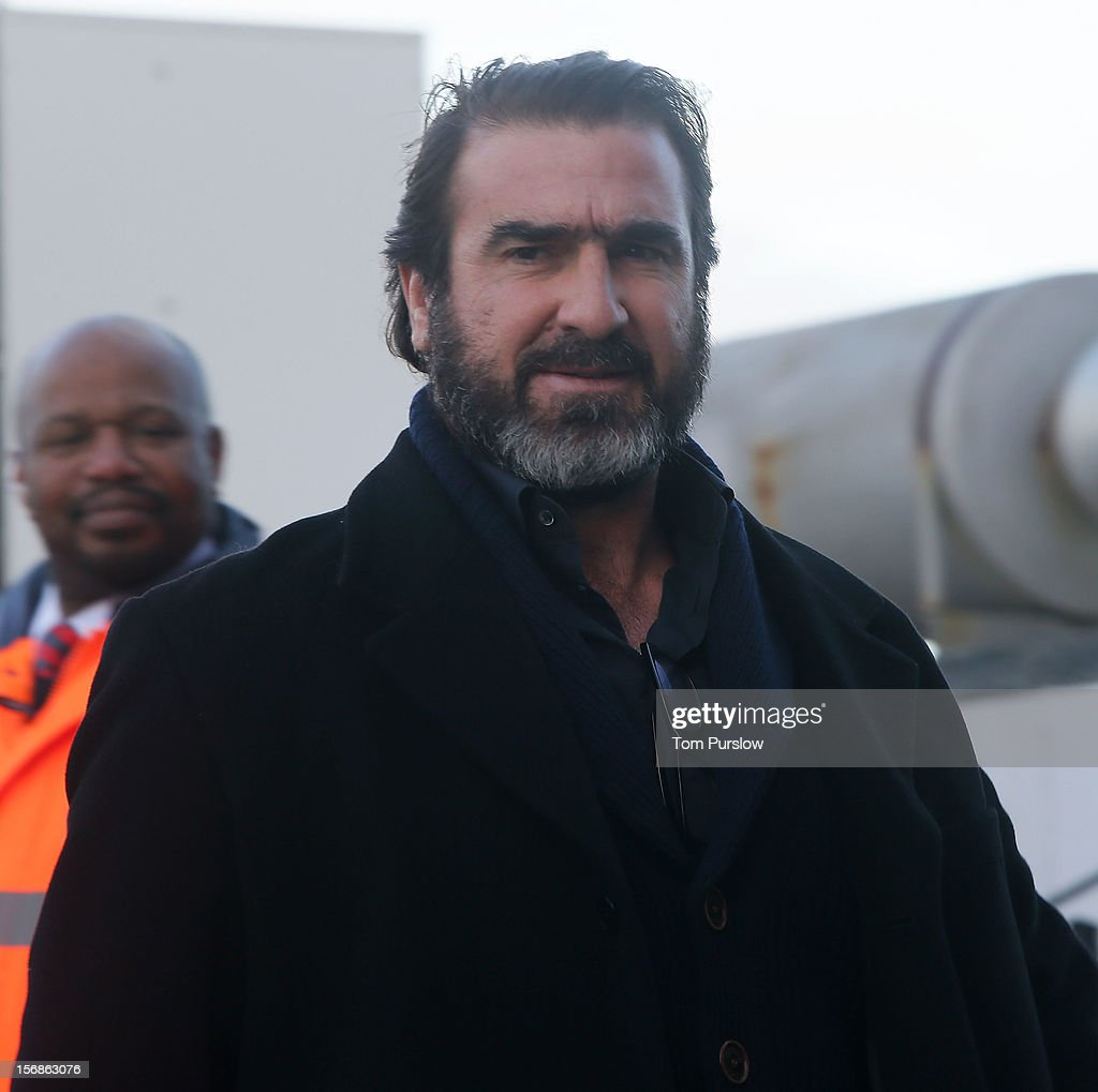 <a gi-track='captionPersonalityLinkClicked' href=/galleries/search?phrase=Eric+Cantona&family=editorial&specificpeople=211325 ng-click='$event.stopPropagation()'>Eric Cantona</a> arrives for the unveiling of a statue of Manager Sir Alex Ferguson of Manchester United at Old Trafford on November 23, 2012 in Manchester, England.