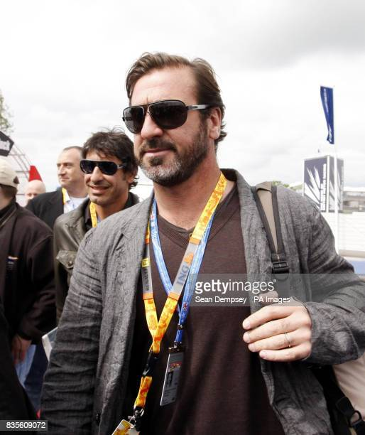 Eric Cantona arrives in the paddock before the British Grand Prix at Silverstone Northamptonshire