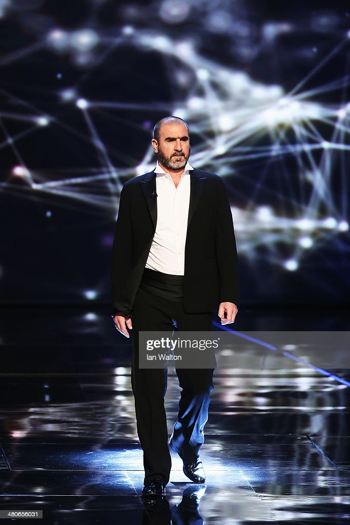 Eric Cantona arrives on stage during the 2014 Laureus World Sports Award show at the Istana Budaya Theatre on March 26, 2014 in Kuala Lumpur, Malaysia.
