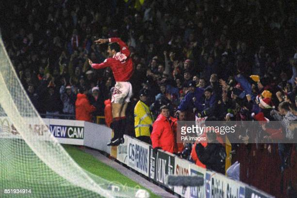 Eric Cantona celebrates with the Old Trafford crowd after scoring his second goal for Manchester United against Aston Villa