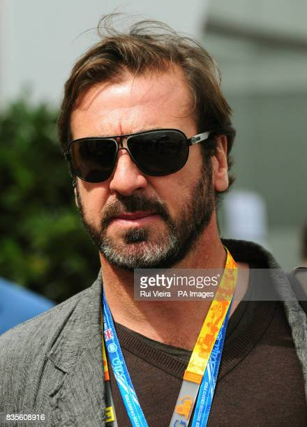 Eric Cantona in the paddock before the British Grand Prix at Silverstone Northamptonshire