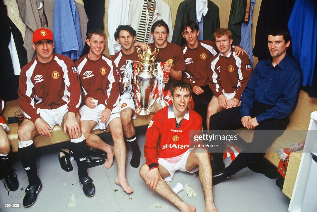 Eric Cantona, Nicky Butt, Ryan Giggs, David Beckham, Gary Neville, Paul Scholes, Roy Keane and Phil Neville of Manchester United celebrate in the dressing room with the FA Carling Premiership trophy after the match between West Ham United v Manchester United at Upton Park on May 11, 1997 in London. Manchester United 2 West Ham United 0.