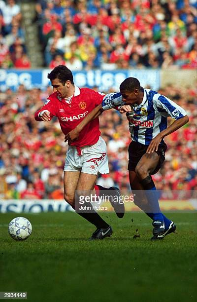 Eric Cantona of Manchester United and Carlton Palmer of Sheffield Wednesday compete for the ball during the FA Carling Premiership match between...