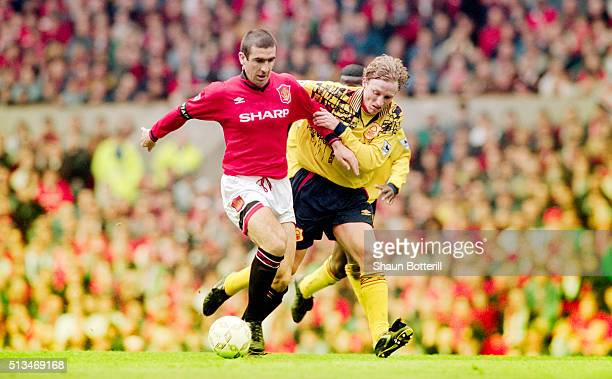 Eric Cantona of Manchester United holds off the challenge of Scott Gemmill of Forest during an FA Carling Premiership match against Nottingham Forest...