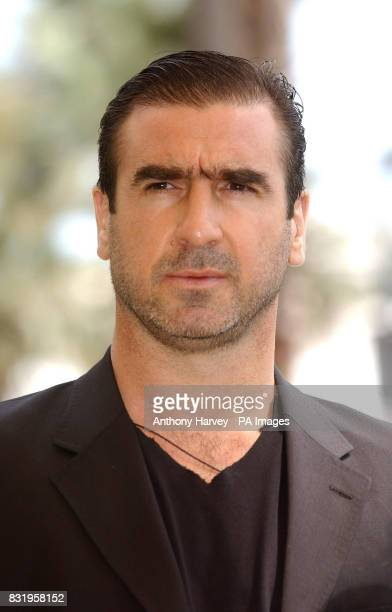 AP OUT Eric Cantona poses for photographers during the photocall for 'Le Deuxieme Souffle' at the Carlton Hotel during the 59th Cannes Film Festival...