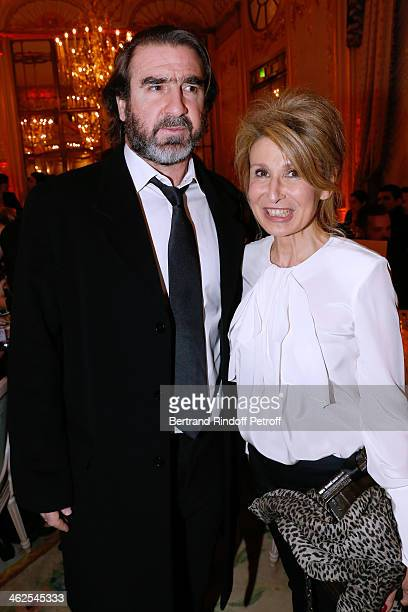 Eric Cantona with Chief editor of Madame Figaro Anne Florence Schmitt at the Chaumet's Cocktail Party for Cesar's Revelations 2014 at Musee Chaumet...