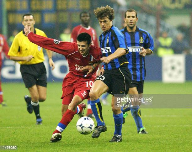 Eric Carriere of Lyon battles with Matias Alymeda of Inter Milan during the UEFA Champions League First Phase Group C match between Inter Milan and...