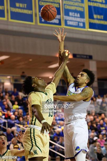 Eric Carter of the Delaware Fightin Blue Hens shoots the ball over Nathan Knight of the William Mary Tribe during the first half at the Bob Carpenter...