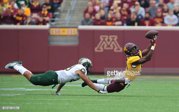 Eric Carter of the Minnesota Golden Gophers catches a pass in the first quarter while Justin Sweet of the Colorado State Rams attempts the tackle at...