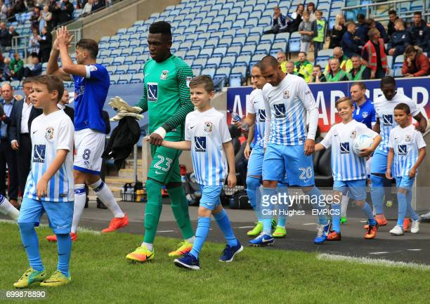 Eric CharlesCook Coventry City walks out with a mascot