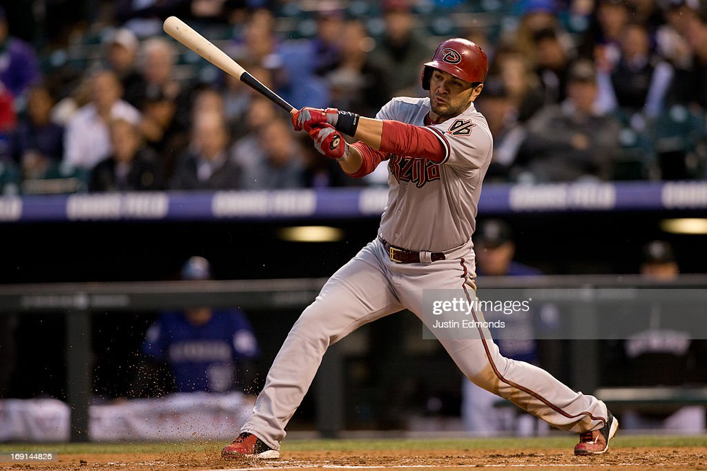 <a gi-track='captionPersonalityLinkClicked' href=/galleries/search?phrase=Eric+Chavez&family=editorial&specificpeople=201561 ng-click='$event.stopPropagation()'>Eric Chavez</a> #12 of the Arizona Diamondbacks follows through on an RBI single during the third inning against the Colorado Rockies at Coors Field on May 20, 2013 in Denver, Colorado. The Diamondbacks defeated the Rockies 5-1.