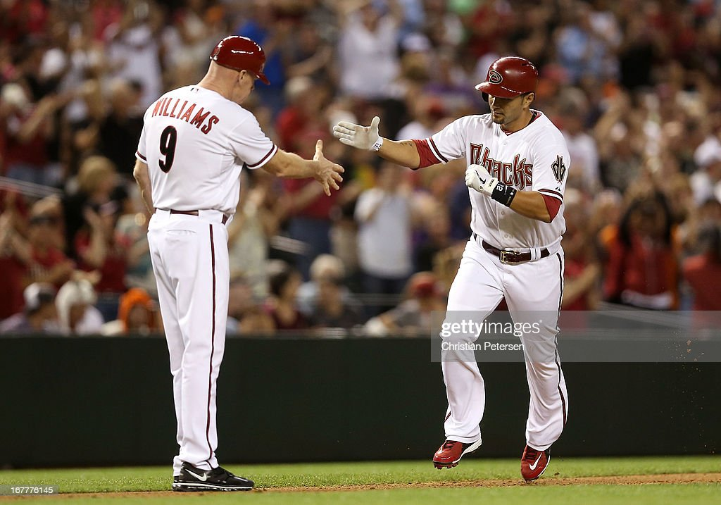 <a gi-track='captionPersonalityLinkClicked' href=/galleries/search?phrase=Eric+Chavez&family=editorial&specificpeople=201561 ng-click='$event.stopPropagation()'>Eric Chavez</a> #12 of the Arizona Diamondbacks high fives third base coach Matt Williams after hitting a solo home run against the San Francisco Giants during the fourth inning of the MLB game at Chase Field on April 29, 2013 in Phoenix, Arizona.