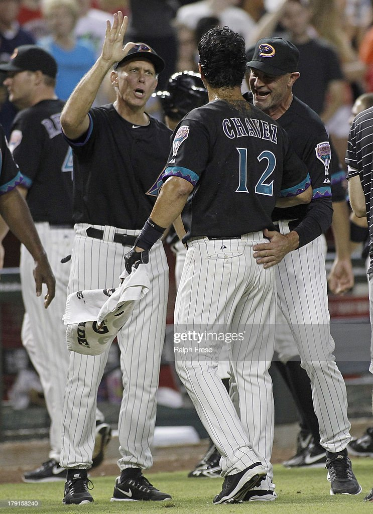<a gi-track='captionPersonalityLinkClicked' href=/galleries/search?phrase=Eric+Chavez&family=editorial&specificpeople=201561 ng-click='$event.stopPropagation()'>Eric Chavez</a> #12 of the Arizona Diamondbacks is congratulated by manager <a gi-track='captionPersonalityLinkClicked' href=/galleries/search?phrase=Kirk+Gibson&family=editorial&specificpeople=207042 ng-click='$event.stopPropagation()'>Kirk Gibson</a> #23 and coach <a gi-track='captionPersonalityLinkClicked' href=/galleries/search?phrase=Alan+Trammell&family=editorial&specificpeople=239515 ng-click='$event.stopPropagation()'>Alan Trammell</a> #3 following his game-winning walk-off RBI single against the San Francisco Giants in the ninth inning of a MLB game at Chase Field on August 31, 2013 in Phoenix, Arizona. The Diamondbacks won the game 4-3.