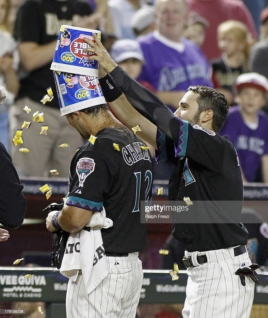 Eric Chavez #12 of the Arizona Diamondbacks is crowned with two buckets of bubble gum by teammate Adam Eaton #6 following his game-winning walk-off RBI single against the San Francisco Giants in the ninth inning of a MLB game at Chase Field on August 31, 2013 in Phoenix, Arizona. The Diamondbacks won the game 4-3.