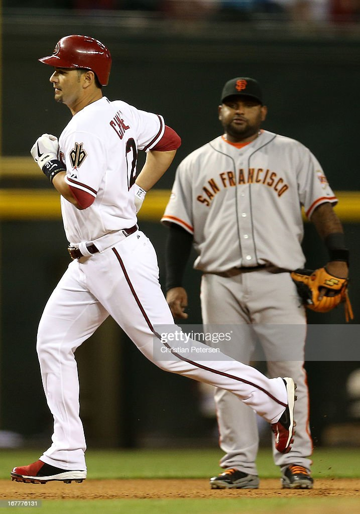 Eric Chavez #12 of the Arizona Diamondbacks rounds the bases ahead of infielder Pablo Sandoval #48 of the San Francisco Giants after Chavez hit solo home run during the fourth inning of the MLB game at Chase Field on April 29, 2013 in Phoenix, Arizona.