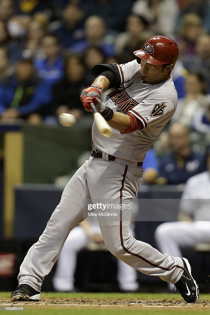 <a gi-track='captionPersonalityLinkClicked' href=/galleries/search?phrase=Eric+Chavez&family=editorial&specificpeople=201561 ng-click='$event.stopPropagation()'>Eric Chavez</a> #12 of the Arizona Diamondbacks singles off this pitch in the top of the second inning against the Milwaukee Brewers at Miller Park on April 6, 2013 in Milwaukee, Wisconsin.