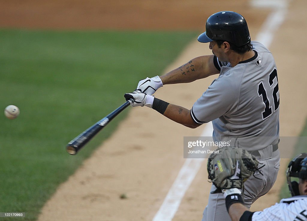 Eric Chavez #12 of the New York Yankees hits the ball against the Chicago White Sox at U.S. Cellular Field on August 3, 2011 in Chicago, Illinois. The Yankees defeated the White Sox 18-7.