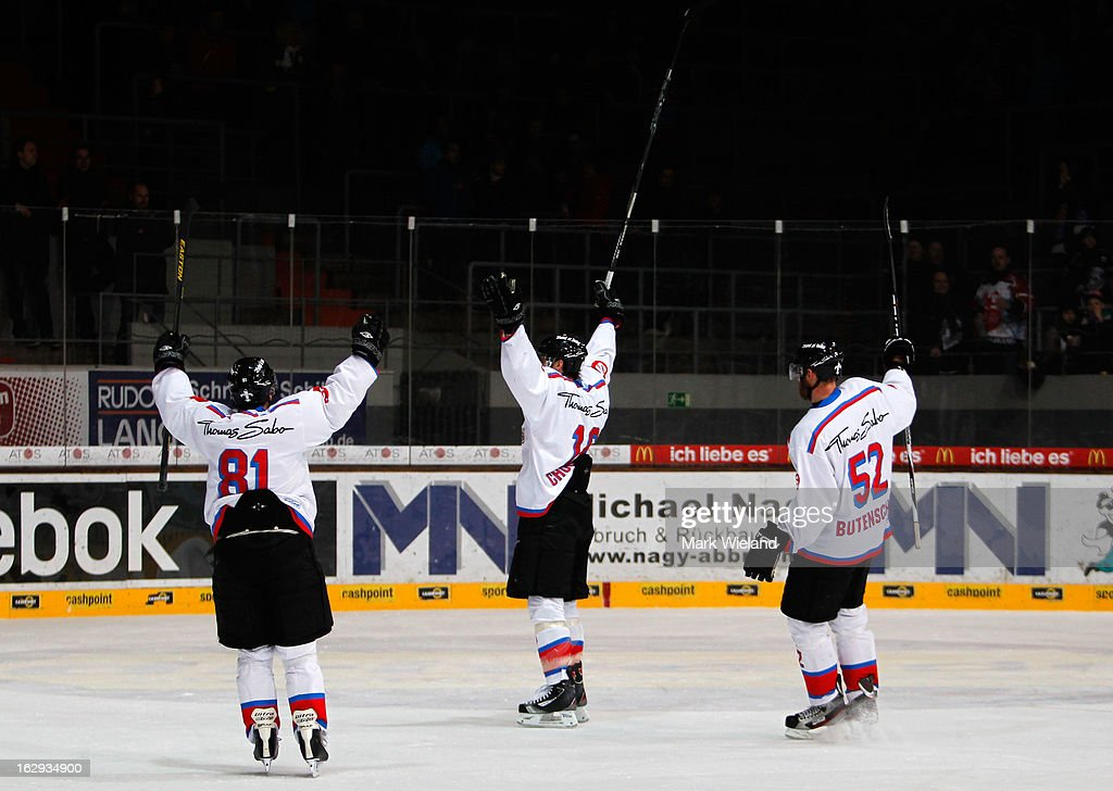 Eric Chouniard of Thomas Sabo Ice Tigers celebrates scoring with team mates during the DEL match between EHC Red Bull Muenchen and Thomas Sabo Ice Tigers at Olympia Eishalle on March 1, 2013 in Munich, Germany.