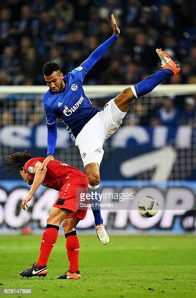 Eric Chuopo Moting of Schalke heads for the ball with Julian Baumgartlinger of Leverkusen during the Bundesliga match between FC Schalke 04 and Bayer...