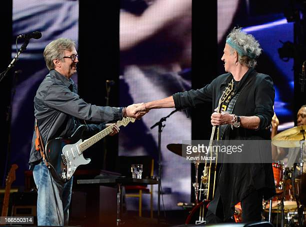 Eric Clapton and Keith Richards perform on stage during the 2013 Crossroads Guitar Festival at Madison Square Garden on April 13 2013 in New York City