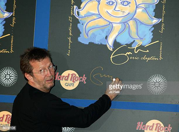 Eric Clapton legendary guitarist signs tshirts to benefit Crossroads Centre Antigua on March 12 2004 at the Hard Rock Cafe in London