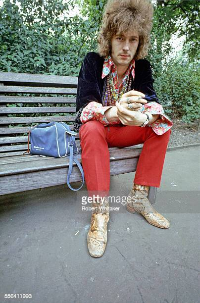 Eric Clapton of Cream pictured smoking on a park bench London May 1967