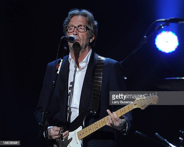 Eric Clapton performs at '121212' a concert benefiting The Robin Hood Relief Fund to aid the victims of Hurricane Sandy presented by Clear Channel...